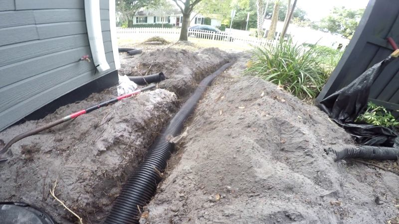 Solid Pipe Discharge from French Drain, leads to discharge at Curb, Apple Drains